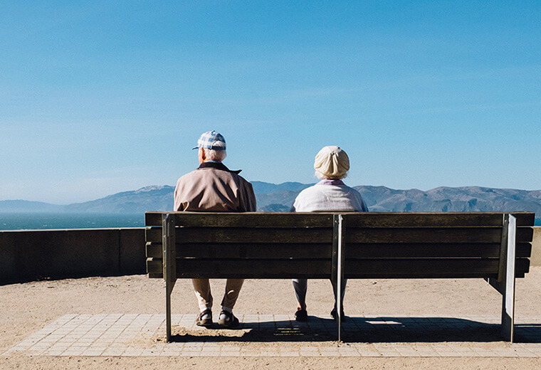 old couple sitting in a bench